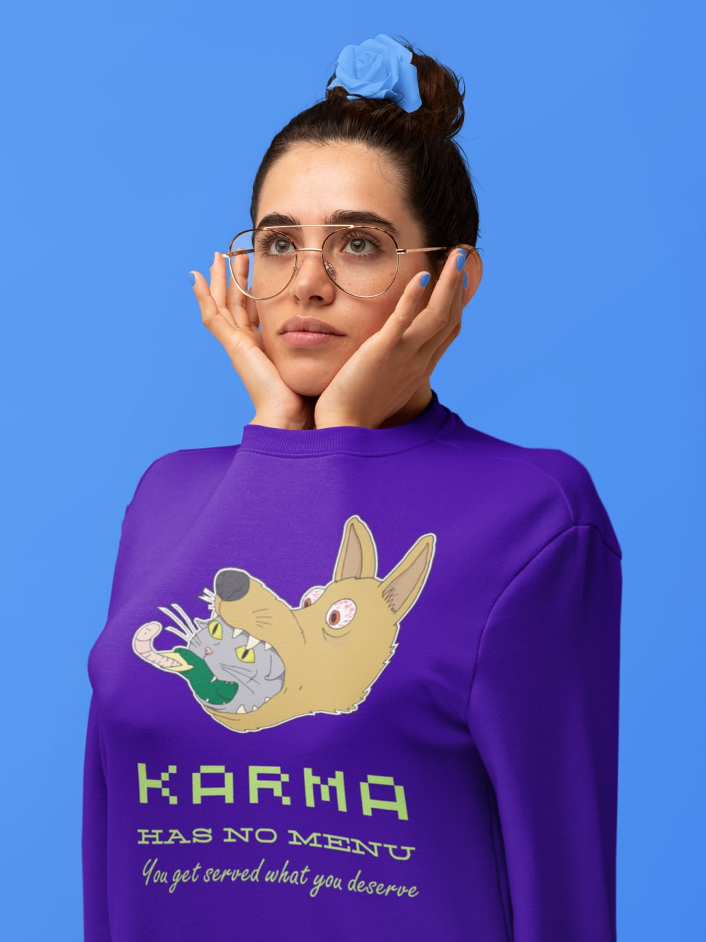 woman with her arms inside a lila sweatshirt