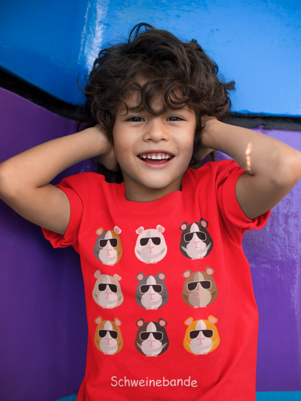 smiling boy with red T-Shirt guineapigs  on it