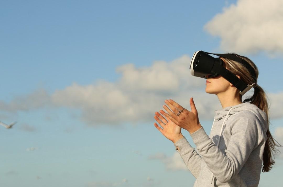A woman experiences virtual reality through a headset