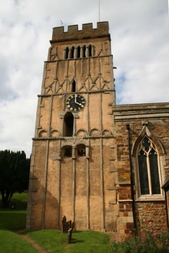 The tower of All Saint's Church, Earl's Barton, Northamptonshire. The stone 'strapwork' remembers wooden construction: photo, Wikimedia Commons
