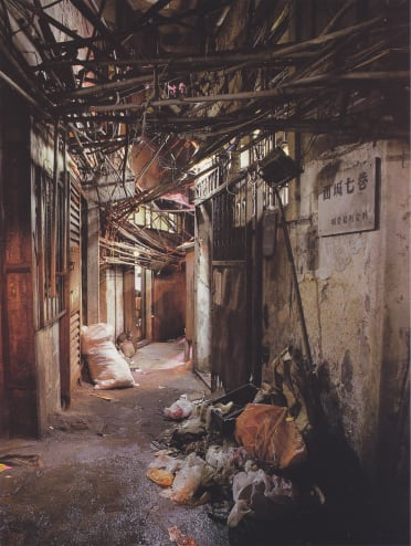 A corridor in the Walled City: photo by Ian Lambot from <em>City of Darkness</em>, 1993