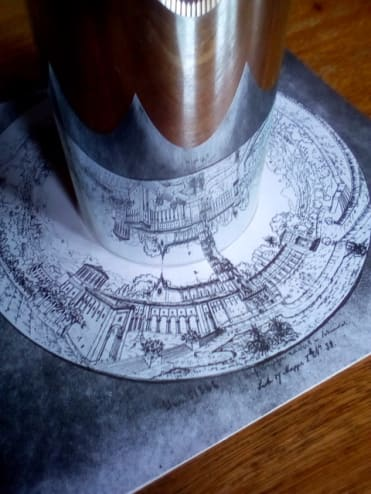 Schinkel's flat ring-shaped drawing of the Palermo panorama, seen in a cylindrical mirror. The reflected image is upside down.
