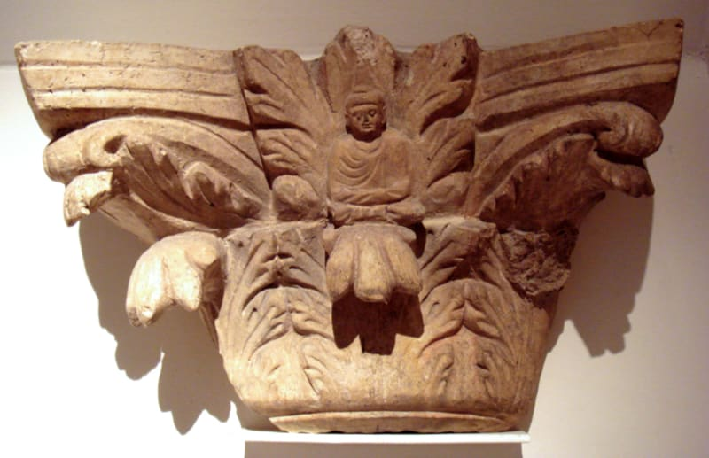 An Indo-Corinthian capital with a figure of the Buddha, in the Musée Guimet in Paris