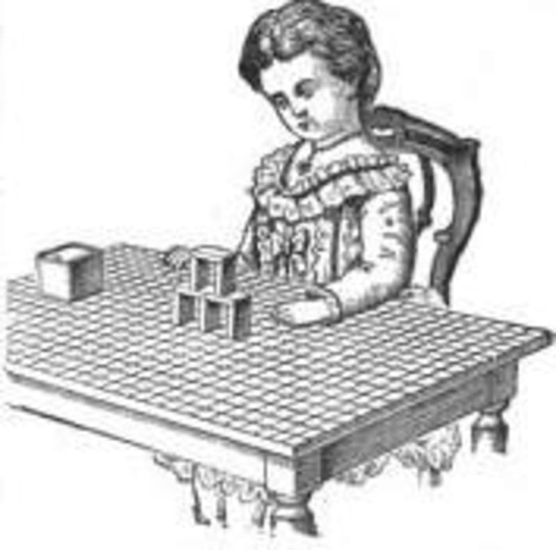 A child playing with Froebel's Gift 4, on a gridded tabletop. Image from Wikipedia