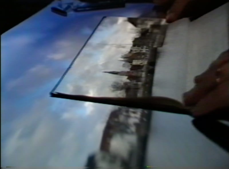 The scene – as it is today – depicted by Vermeer in his 'View of Delft', projected onto a horizontal screen in a tent camera obscura. The sketchbook belongs to Rolf Harris, who was surprised to find the View on the page, and even more surprised to find it again on the next page, when he turned over.