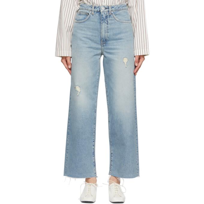Totême Blue Flare Jeans In 404 Distressed Lt Bl
