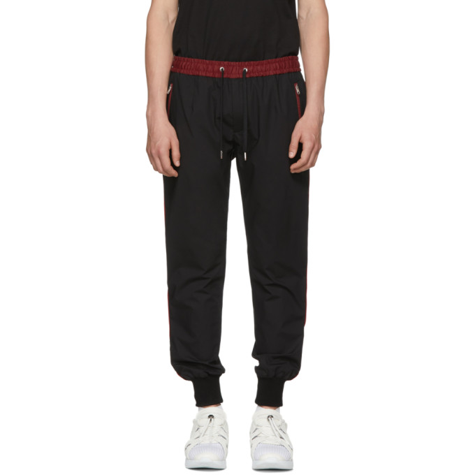 DOLCE AND GABBANA BLACK AND RED STRIPE CUFF TROUSERS