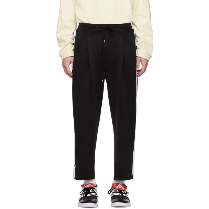 ADER ERROR Striped Track Pants in Black