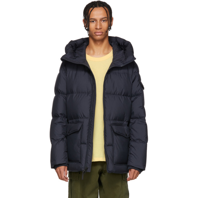 a7f35d1ab067 ... Long sleeve down filled quilted technical satin jacket in blue.  Elasticized drawstring at hood. Two way zip closure at front. Flap pockets  at waist.