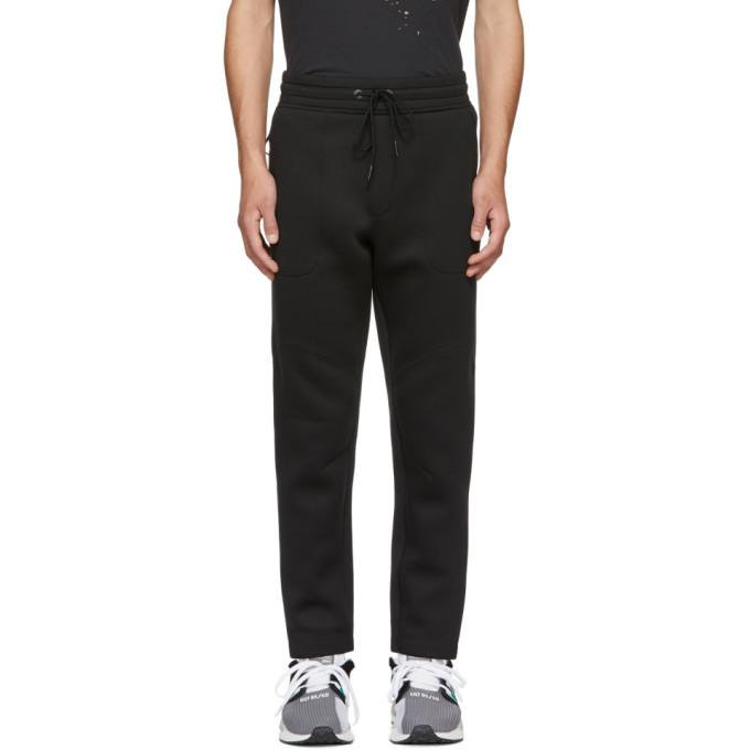 ISAORA Pantalon de survetement en neoprene noir exclusif a SSENSE