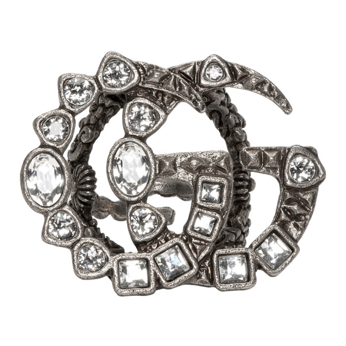 3e292b0bb Gucci Silver GG Marmont Ring $420.00 Open band ring in antiqued silver  tone. Logo hardware featuring crystal cut detailing at face.
