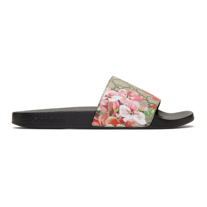 9e294b443 Gucci Multicolor Floral GG Supreme Slides 'Supreme' coated canvas slip on  sandals featuring logo pattern in tones of beige and brown. Open round toe.