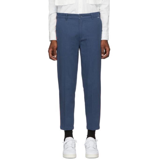Dickies Construct Pantalon fusele bleu marine et rouge Strip exclusif a SSENSE