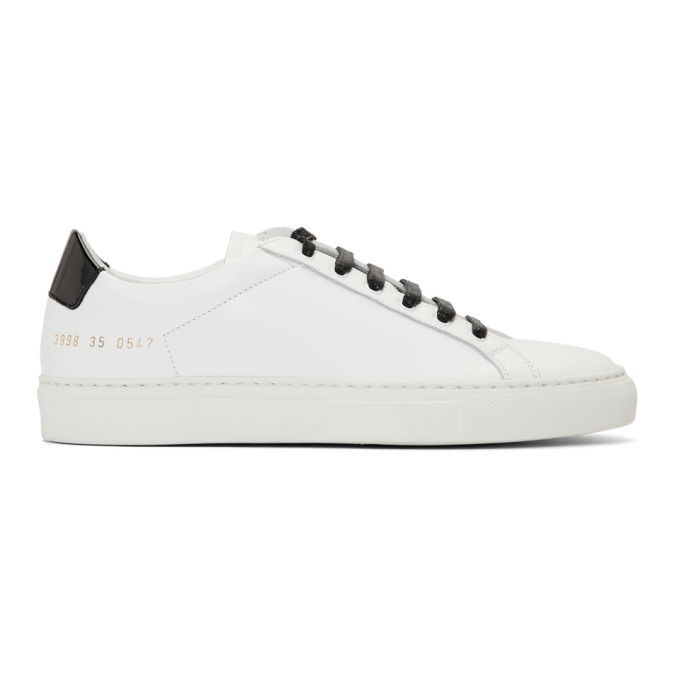 Woman by Common Projects White and Black Retro Low Glossy Sneakers