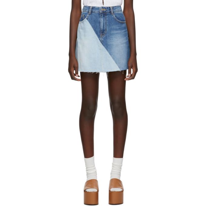 SJYP Mini-jupe en denim contrastee bleue