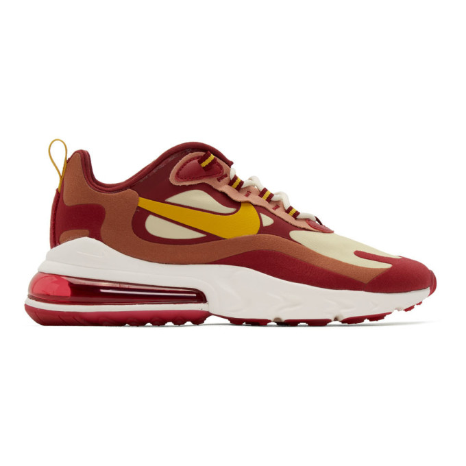red and yellow nike shoes