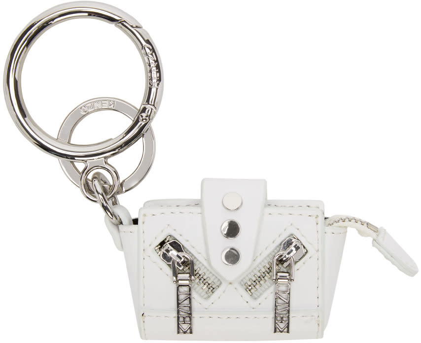 97a39570daf Bagshaped charm featuring zippered compartment. Keyring and ring clasp  hardware. Gunmetaltone hardware. Tonal stitching. Approx. 6 length x 2.5  height.