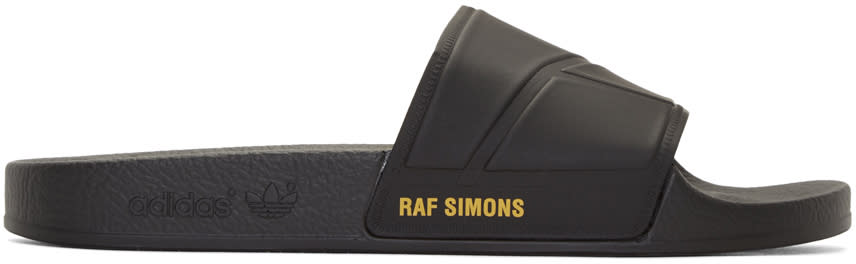 Image of Raf Simons Black Adidas Originals Edition hold Firmly This Side Up Adilette Bunny Sandals