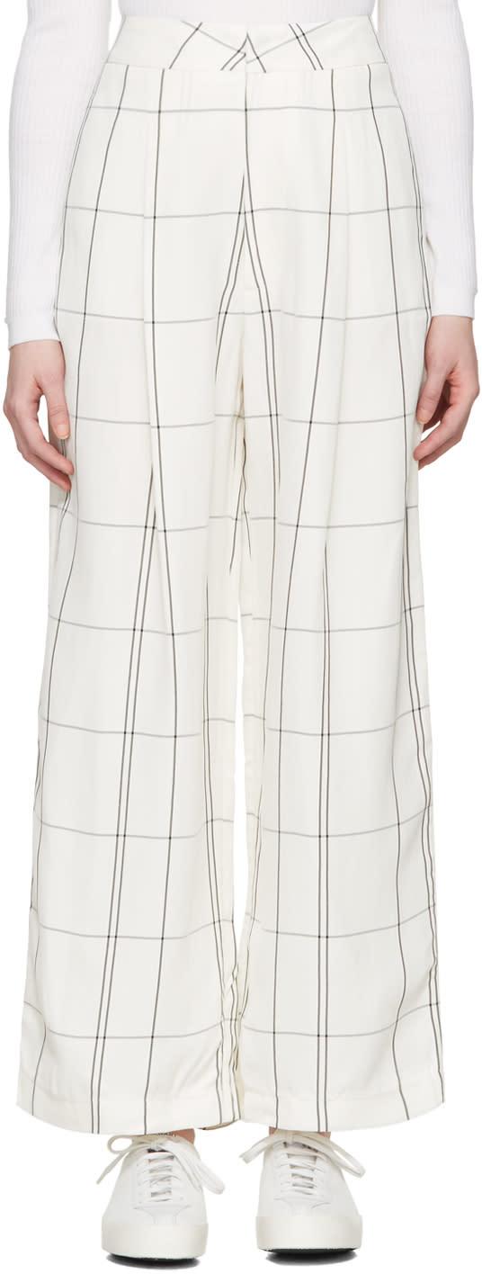 Image of Studio Nicholson Ivory Check Balloon Trousers