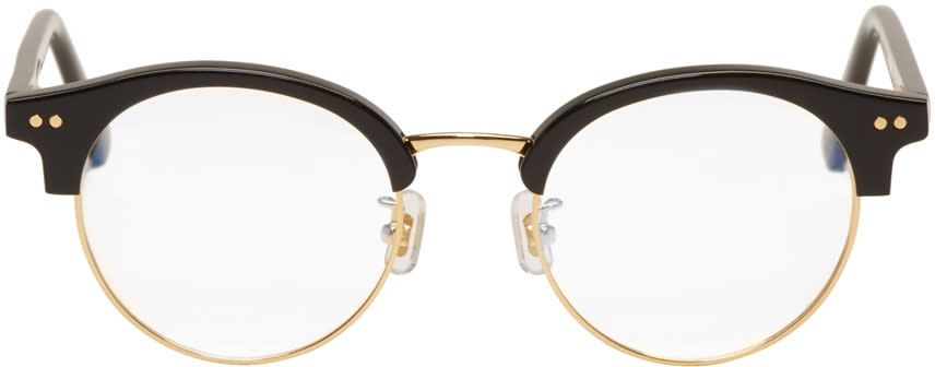 Image of Gentle Monster Black and Gold blue Moon Glasses