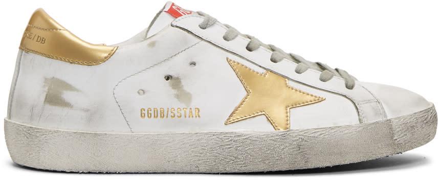 Golden Goose ホワイト and ゴールド スーパースター スニーカー