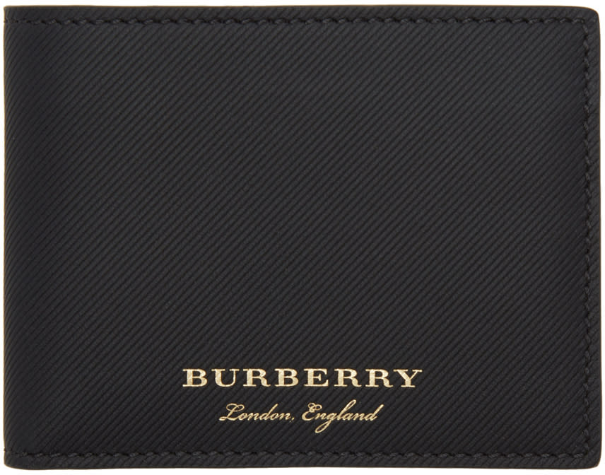 97be6246a784 Burberry Black Leather Hipfold Wallet  345.00 Trench leather bifold wallet  in black. Logo stamp in goldtone at face. Card slots