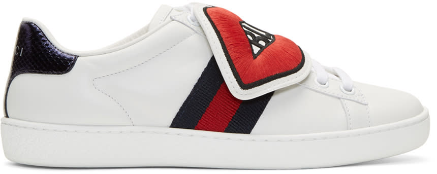 454d429e99d4 Gucci White blind For Love Ace Sneakers Lowtop buffed leather sneakers in  white. Round toe. Tonal laceup closure. Mismatched detachable embroidered  ...
