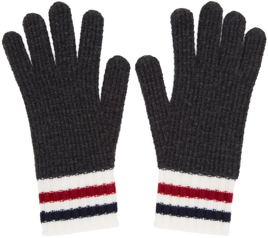 86446d0c8e4 Moncler Gamme Bleu Grey Wool Gloves Knit virgin wool gloves in dark grey.  Tricolor stripes at rib knit cuffs. Tonal stitching.  260.00