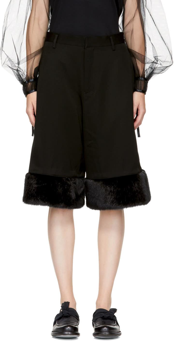 Image of Noir Kei Ninomiya Black Faux-fur Cuff Trousers