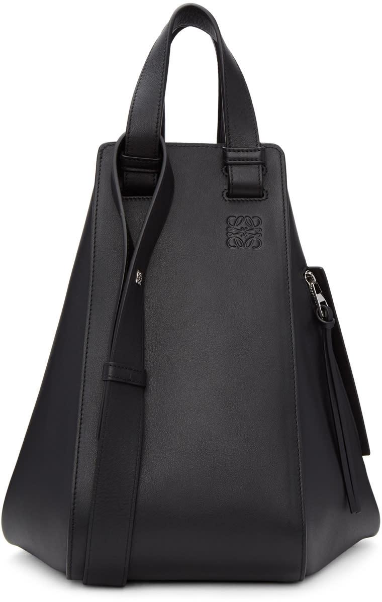87b6e5342b8 Loewe Black Medium Hammock Bag Classic calfskin tote in black. Twin carry  handles at top. Convertible and adjustable shoulder strap with poststud  fastening.