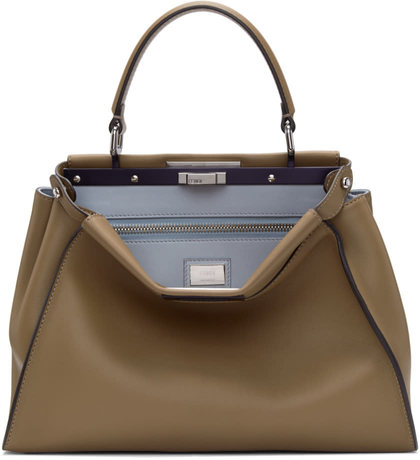 0e7b7a1a8ce2 Fendi Tan Regular Peekaboo Bag Buffed calfskin twincompartment duffle bag  in sand tan. Carry handle at top. Detachable and adjustable shoulder strap  with ...