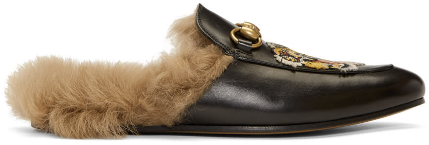 bdf6d0ccb64 Gucci Black Wool lined Tiger Princetown Slippers Buffed leather slip on  loafers in black. Embroidered appliqués and signature horsebit hardware at  vamp.
