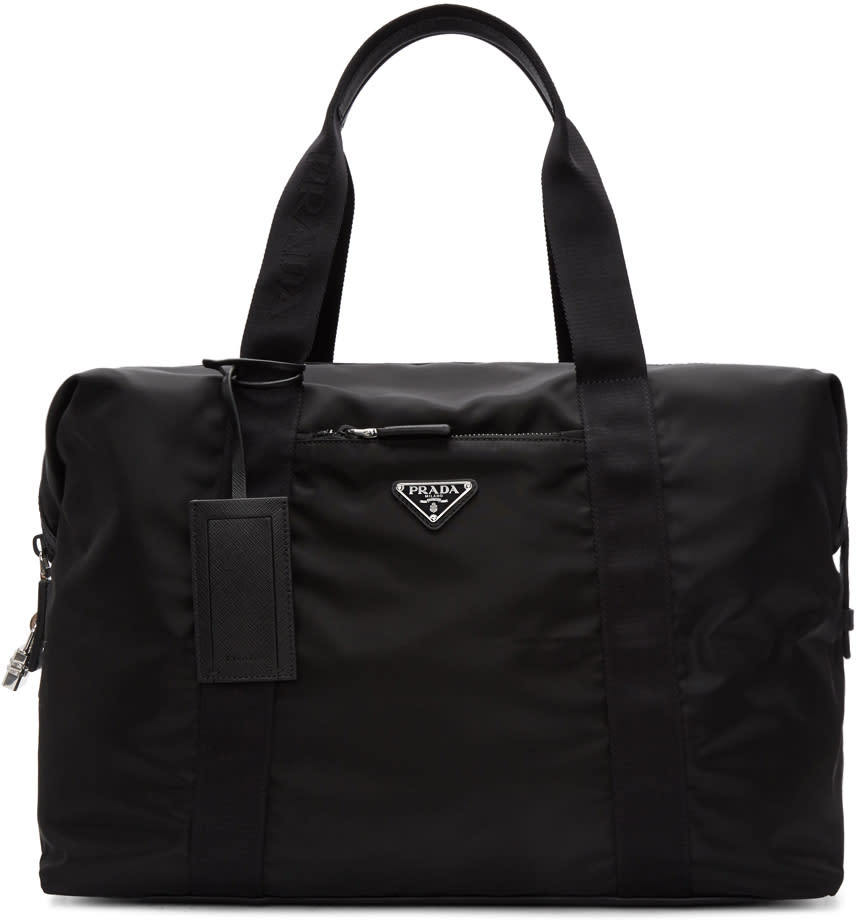 1d7df137cb45af Prada Black Nylon Duffle Bag $1100.00 Nylon gabardine duffle bag in black.  Saffiano leather trim throughout. Twin structured webbing carry handles at  top ...