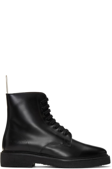 ab448e1d92a4 Woman by Common Projects Black Standard Combat Boots from SSENSE ...