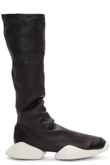 Miu Miu: Black Patent Ankle Boots | SSENSE