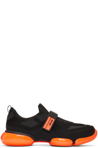 39f256f0 Prada: Black & Orange Cloudbust Sneakers | SSENSE