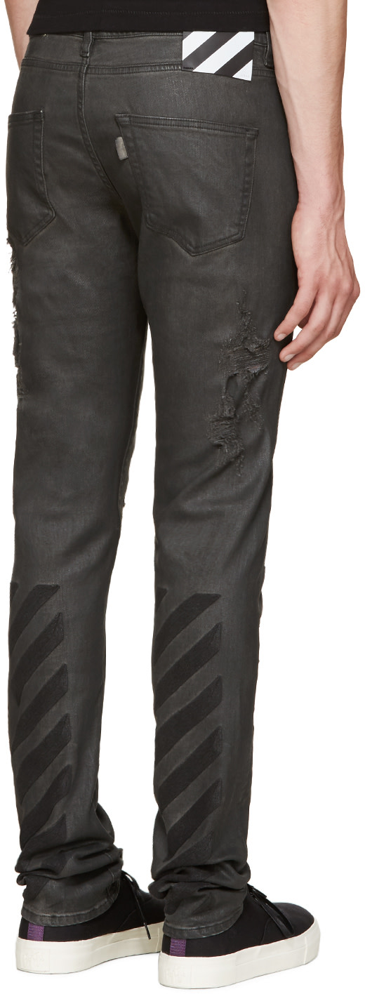 Off-White: Black Distressed Coated Jeans | SSENSE
