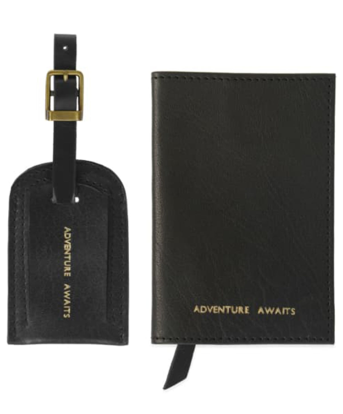 black luggage tag and passport cover stamped in gold with the words adventure awaits