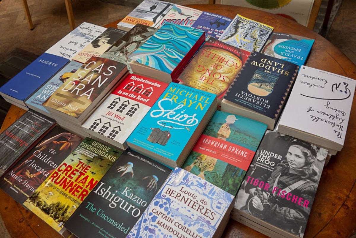 tabletop display of colorful books at Daunt Books in London
