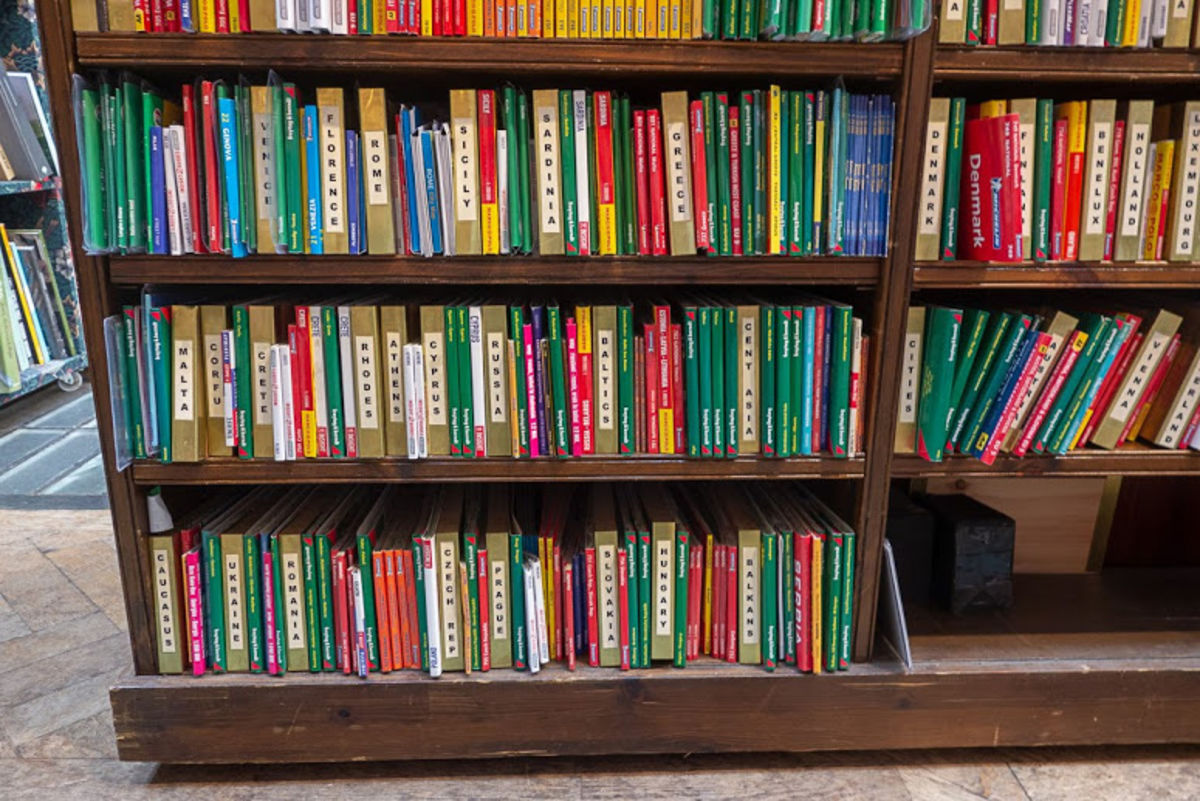 colorful travel guide books at Daunt Books