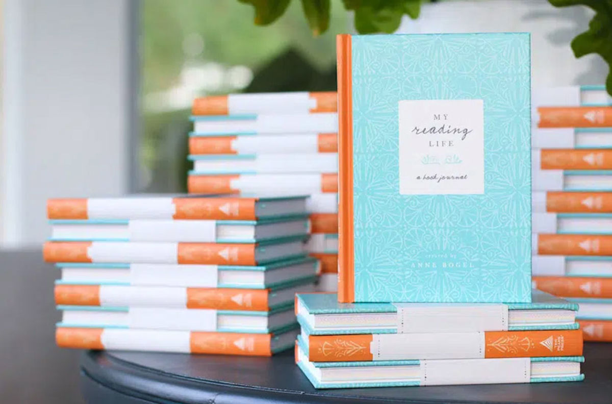 stacks of the torquoise and coral colored journal