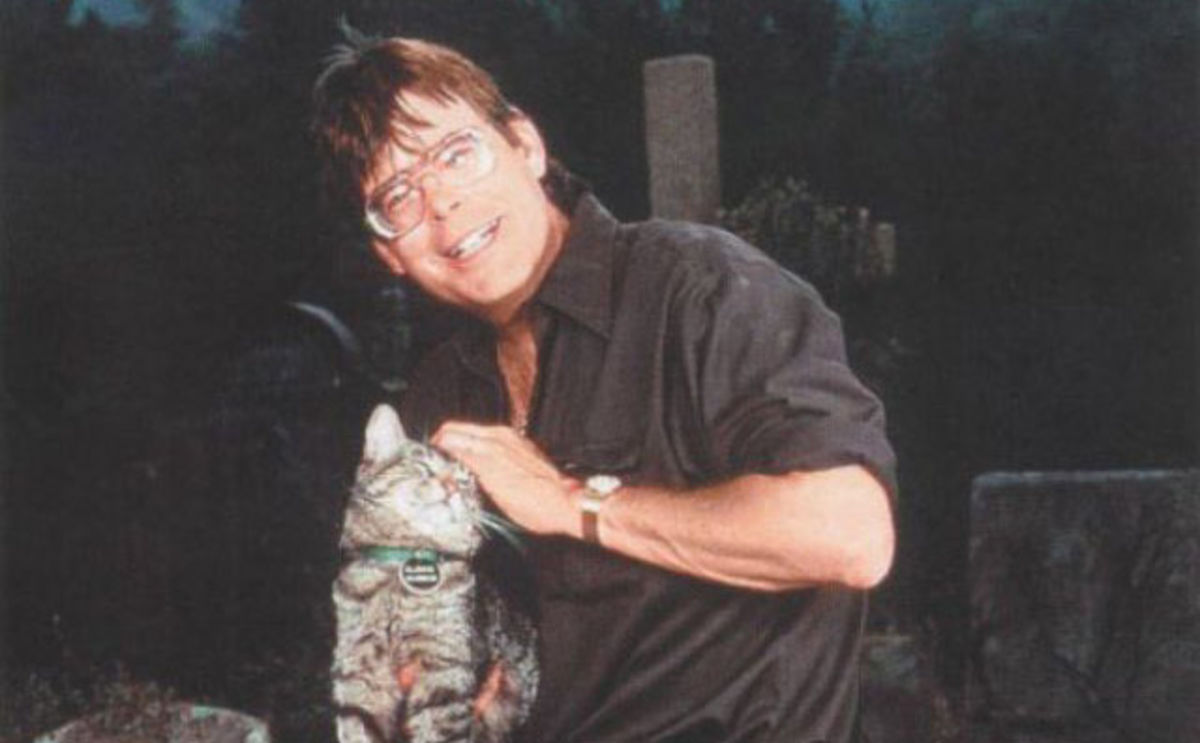 author stephen king holding a cat