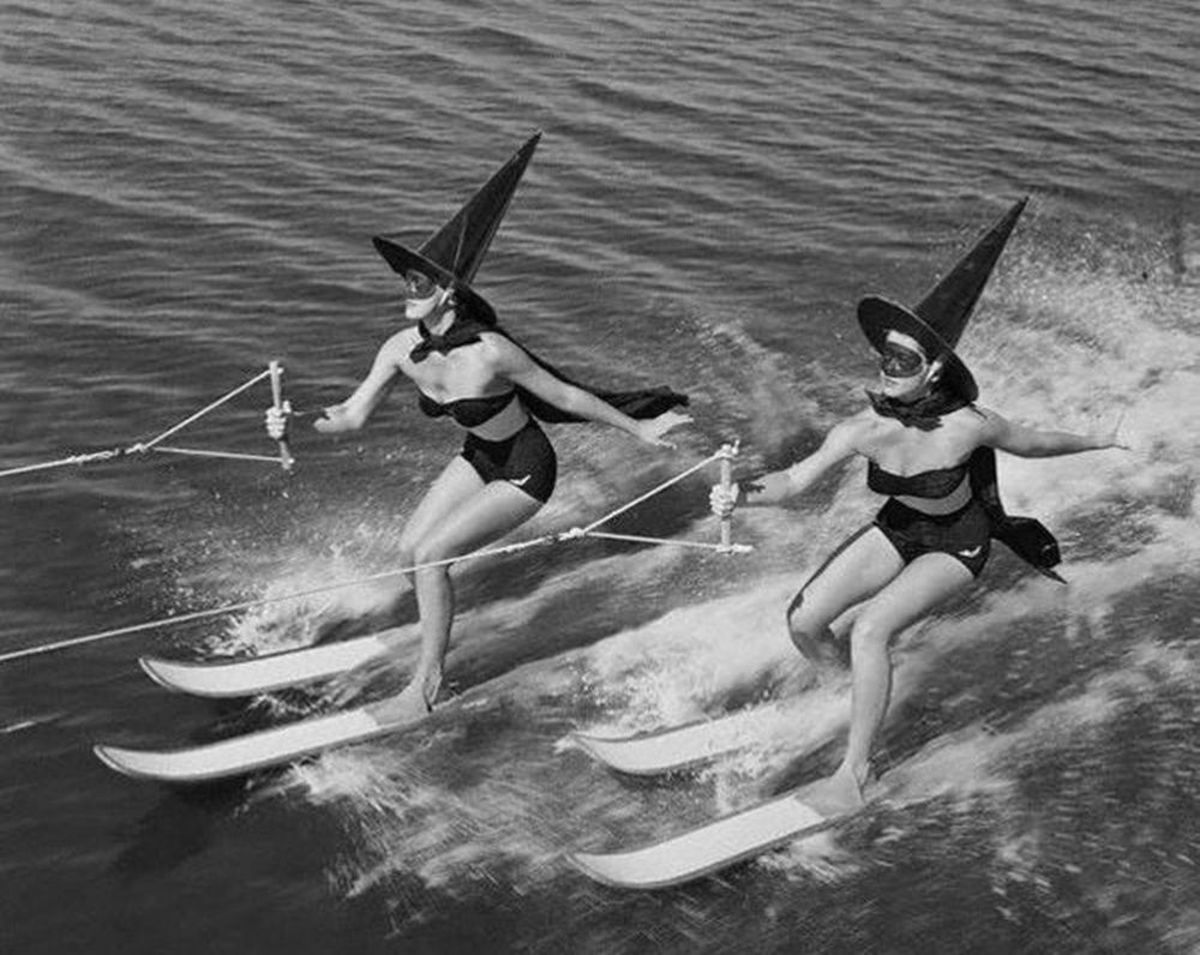 women dressed as witches on water skis