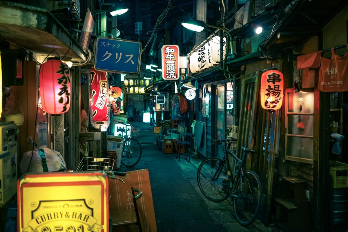 busy tokyo street with neon signs