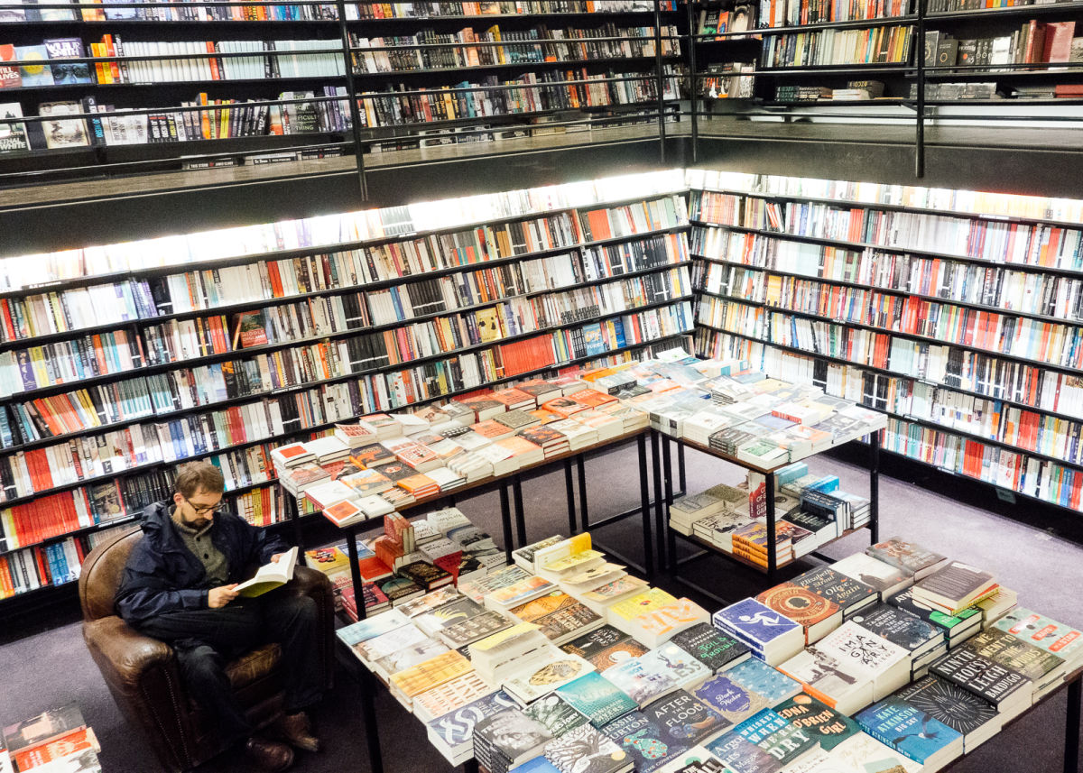 english language section of the store with easy chairs