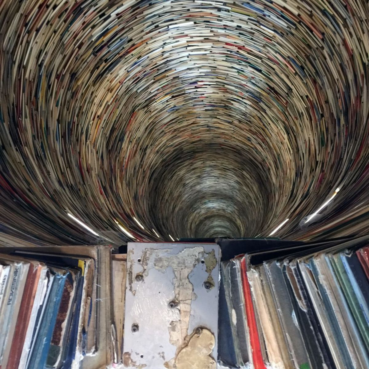 inside a colorful tower made of books