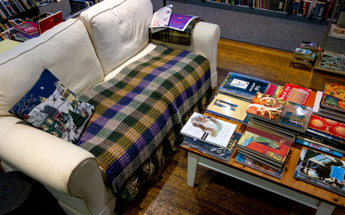 couch and a table of books