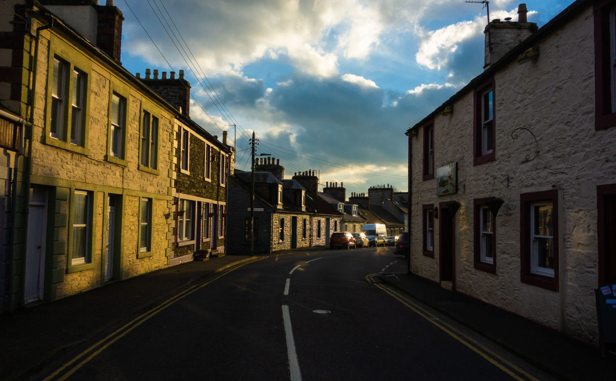 bright sunrise over the buildings of wigtown