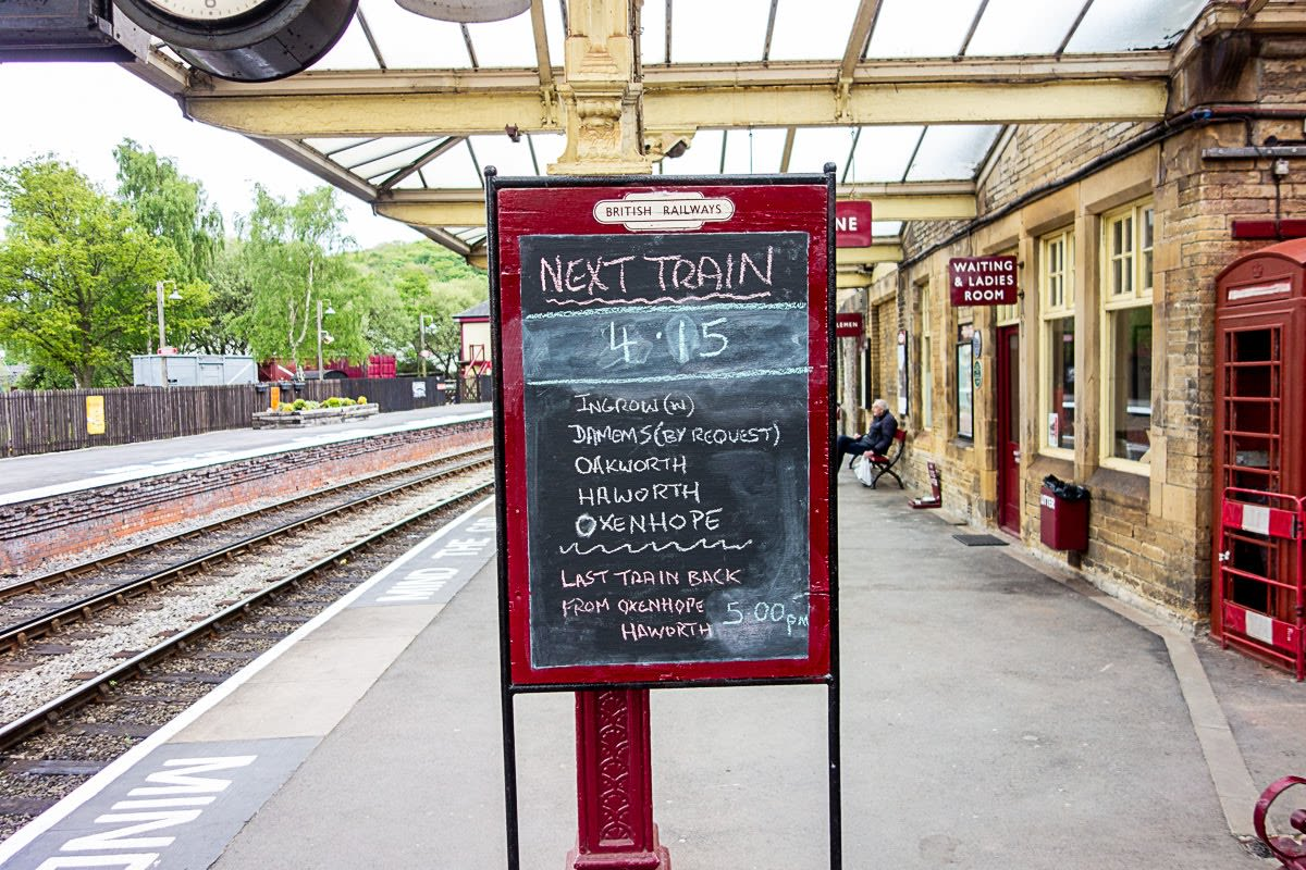maroon signs at the keighley train station