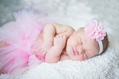newborn in tutu photo by portrait artist mike theuer